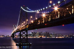 Stars and Steel (Paul Porter Photography) Tags: sanfrancisco longexposure bridge light fog night liberty freedom evening nikon cityscape nightscape d70s free clarity nightshoot baybridge bayarea starburst lightscape yerbabuenaisland sanfranciscobaybridge urbannight urbanlights sanfranciscooaklandbaybridge supensionbridge