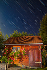 My First Star Trail Work (M3xx) Tags: longexposure blue sky house night canon stars star hungary lodge trail tamron meteorite startrail fallingstar 50d