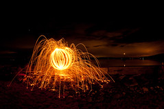 Steel wool orb (Northwest dad) Tags: light beach wool water painting island cool nikon steel fisheye sparks 8mm whidbey d300 samyang prooptic