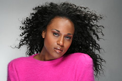 woman (jnelson571) Tags: pink portrait people woman canada black color colour cute girl beautiful smiling fashion female hair studio happy person grey sweater outfit clothing model long pretty dress adult natural emotion expression african gorgeous traditional young culture posing diversity lifestyle happiness blowing curly american attractive lovely cheerful ethnic isolated cultural stylish ethnicity nigerian