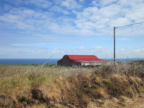 Red roof against an impossibly perfect sea and sky