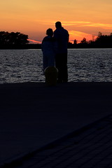 The Fire Still Burns (jah32) Tags: sunset ontario canada color colour love water silhouette harbor couple collingwood harbour greatlakes lakehuron cmwdorange