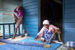 0553 The mat weaver and her camera-shy sister--Sabah , Malaysia (ngchongkin) Tags: blue malaysia cocacola weaver sabah nationalgeographic colorphotoaward flickrbronzeaward heartawards discoveryphotos mygearandme ringexcellence