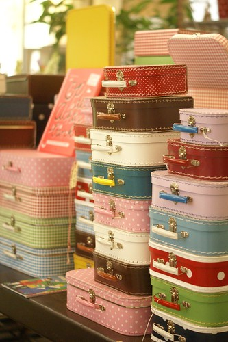 packing suitcases by wood & wool stool