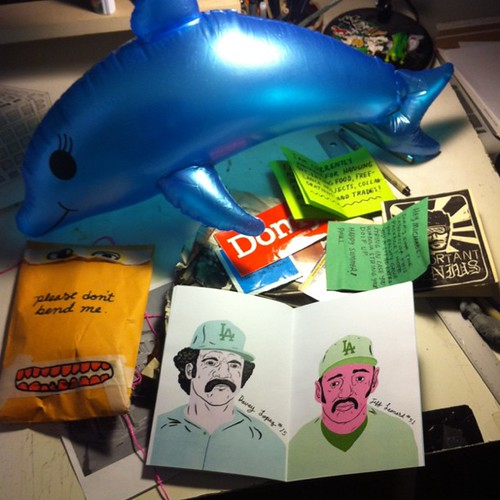 Okay amazing package by Paul Windle- Rad zines and an inflatable dolphin. by Michael C. Hsiung