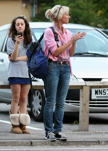 pink woman beautiful sunglasses standing furry boots top candid surrey blouse mature blonde mobilephone redhill pigtails miniskirt northdowns youngwoman clapping ugg texting onthehead denimjeans eoshe canoneos450d gattonhall