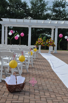 Ceremony aisle with yellow paper lanterns