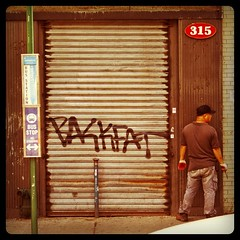 Backfat in Chinatown (astrodub) Tags: newyorkcity streetart newyork square gate chinatown candid busstop squareformat shutter passerby hefe backfat instagramapp