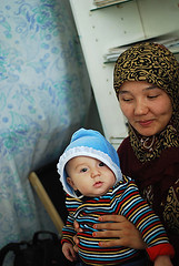 UZB-Fergana-0810-102-v1 (anthonyasael) Tags: road family 2 two portrait woman baby cute love smile smiling vertical closeup asian happy person one holding women asia child adult affection sweet interior stripes muslim central young mother silk adorable happiness center relationship parent single portraiture toothy charming care chubby adults uzbekistan fergana generation prenatal relation ouzbekistan ozbekiston ozbekstan