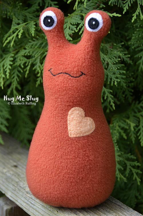 Copper-colored Fleece Hug Me Slug by Elizabeth Ruffing