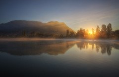 Brume {EXPLORED} (Girolamo's HDR photos) Tags: morning blue light shadow summer sky sun sunlight mist lake france mountains tree nature water sunrise canon reflections french landscape photography gold savoie hdr rayoflight rhnealpes girolamo photomatix tonemapping canoneos50d cracchiolo omalorig wwwomalorigcom
