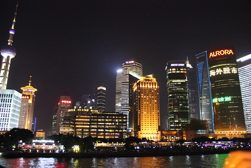 Shanghai nightscape, as seen from a ferry on the Huangpu River by emaggie