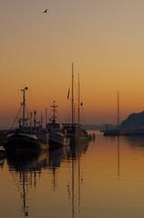 Sunset over Sassnitz/Germany (Owwski) Tags: ocean light sunset sky people water birds boats dawn coast horizon low silhouettes rgen ruegen sassnitz 77mm pentaxlimited