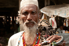 Older Man with Umbrella - Srimongal, Bangladesh (uncorneredmarket) Tags: people man umbrella bangladesh srimongal muslimhat taqiyah sylhetdivision sreemangal