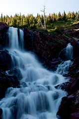 Falls (Dread Pyrat No Beard) Tags: mountains forest waterfall nationalpark montana july glacier redrock oldmanlaketrail pitamakanvalley