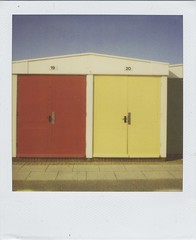 Beach Huts (Lizzie Staley) Tags: blue red summer england white color colour green film beach yellow polaroid sx70 bright path number hut devon 600 instant colourful 20 expired 19 bold roidweek2011