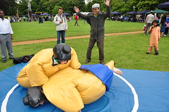 victory? (Margaret Stranks) Tags: uk community suits wrestling churches funday oxford sumo headington 2011 buryknowlepark