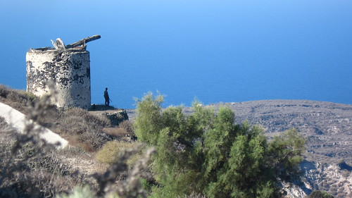 A hunter looks out over the Greek island of Therasia, Santorini.