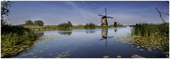 Kinderdijk-Netherlands (Vasilis Mantas) Tags: panorama holland reflection art netherlands windmill canon landscape photography rotterdam kanaal mills kinderdijk 500d vmantas vmantasphotography