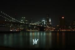 Art of Light (fahid chowdhury) Tags: new york nyc bridge light art water brooklyn night canon river painting photography long exposure shot suspension manhattan great dumbo east boroughs brooklynbridge bulidings xsi fahid chowdhury 1mainstreet citly