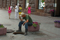 The thinker (Che-burashka) Tags: street people man sitting looking candid citylife streetphotography ukraine smoking manhole kiev easterneurope canonef28mmf18usm khreschatik