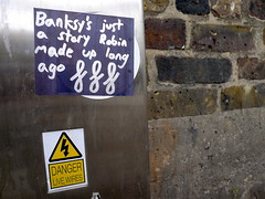 Banksy's just a story (-Curly-) Tags: streetart robin graffiti sticker stickerart stickers banksy curly robingunningham gunningham