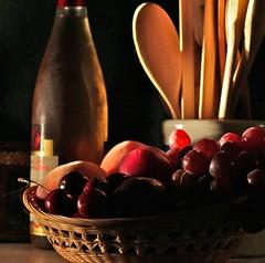 IMG_6853 Still Life (ForestPath) Tags: stilllife fruit basket wine brightlight pottery mead woodenspoons deepshadows beginnerdigitalphotographychallengeswinner thechallengefactory