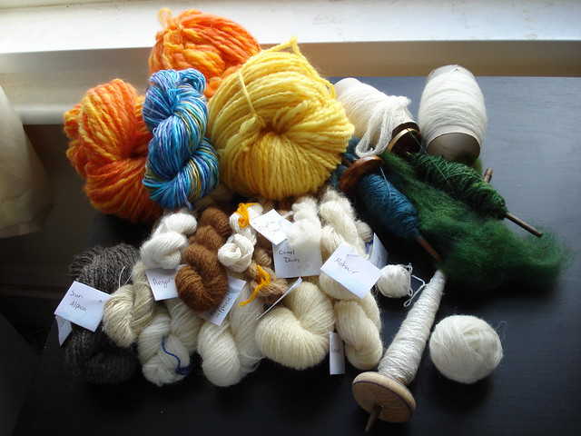 Big pile of handspun tour de fleece spindle spun yarn