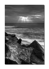 Ray of Hope! (VinothChandar) Tags: longexposure light sea bw sun sunlight india seascape beach water clouds canon dark photography hope boat photo sand rocks exposure ray darkness photos madras wideangle rays sands scape chennai tamilnadu mahabalipuram mamallapuram