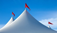 Tents and Pennants (gordeau) Tags: blue light red white tents shadows flags simple threecolours pennants flickrchallengegroup flickrchallengewinner thechallengefactory