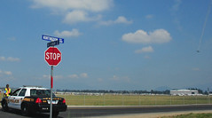 Stop and take in the airshow (D70) Tags: show road white canada black ford leaves car sign clouds for airport bc aircraft smoke air police august off airshow trail stop take blocks local annual squad 12th hanger patrol abbotsford aerobatic interceptor aerodrome 2011