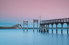 Dawn at Narragansett Bay (Jim Boud) Tags: longexposure morning travel bridge vacation sky seascape sunrise landscape island dawn lights pier crossing pastel newengland rhodeisland newport artisticphotography bulbexposure newportbridge narragansettbay smoothwater silkywater claibornepell jimboud canoneos60d jamesboud canonefs1585mmf3556isusm canon1585mm