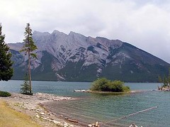 Lake Minnewanka, Banff NP, Canada (Pixmac_com) Tags: trees summer sun canada mountains nature water sunshine weather clouds landscapes daylight rocks seasons horizon lakes bluesky nobody hills vegetation daytime summertime np nationalparks naturalworld exteriors lakeminnewanka waterlevel mountainpeaks summits banffnp utdoors tipofthehills