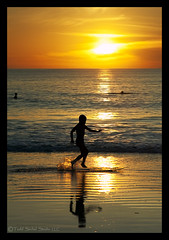 Time to Ride off into the Sunset. (tsechel) Tags: boy sunset bali beach home wet water reflections indonesia sand indianocean wave skimb