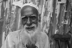Dhaka095 (Guerillaphoto) Tags: travel portrait woman baby white man black ferry train 35mm river children nikon child exploring poor photojournalism documentary rail railway pride smoking shack f2 dhaka dit bangladesh slum ngo photojournalist korail d700 gulishan