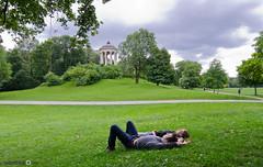 Nice rainy day in Munich (andreaskoeberl) Tags: boy sleeping green girl grass rain germany garden munich bavaria nikon relaxing englishgarden 1116 d7000 tokina1116f28 nikond7000 andreaskoeberl