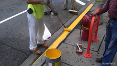 Painting the fire zone curb yellow (Steven Vance) Tags: road street orange wickerpark bike bicycling design wpb bicicleta transportation vlo bikerack ssa roadway dero milwaukeeavenue bikeparking bikecorral wickerparkbucktown onstreetbikeparking ssa33 bikeparkingcorral bikechi wpbrides