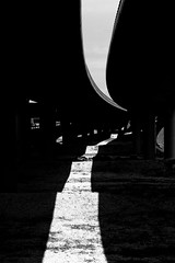 sun is over (Daniel Kulinski) Tags: road street city urban blackandwhite bw white abstract black monochrome car tarmac speed way concrete highway europe image 10 transport under central shapes evil samsung poland move minimal line communication ten warsaw civic simply asphalt minimalistic beton fas nx urbanshapes noclolor samsungimaging nx10 samsungnx10 gettypoland1