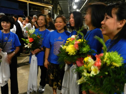 Voluneers in blue shirts with the Kalachakra symbol, hold flowers and khatas, backstage, Kalachakra for World Peace, preparing the mandala offerings to His Holiness the 14th Dalai Lama, Washington D.C., USA by Wonderlane