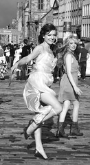 Fringe on the Royal Mile 2011 015 (byronv2) Tags: girls blackandwhite bw woman sexy girl monochrome festival scotland blackwhite women edinburgh legs fringe royalmile performer oldtown 2011 edinburghfestivalfringe fringe2011