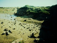Lost Creek (teaselbrush) Tags: ocean camera uk sea england white mill abandoned film beach angel creek river lens landscape toy lost sussex coast town seaside village slim angle mud decay tide wide eerie estuary east spooky coastal newhaven british analogue mills derelict tidal muddy harbout bishopstone superheadz