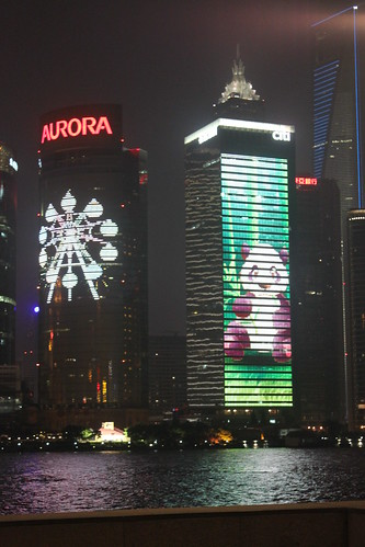 Rotating Advertising on high scraper buildings at Shanghai Bund China