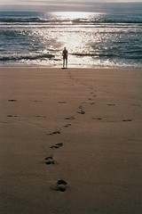 Costa Verde. (P. S. Mildred) Tags: travel sea sun film beach portugal sunshine silhouette analog 35mm sand nikon footprints 200asa 35mmfilm analogue atlanticocean nikkormat kodakfilm viladoconde costaverde gold200 nikkormatftn