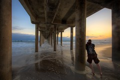 photographer under the pier (Eric 5D Mark III) Tags: ocean california sunset sky people usa cloud seascape color reflection beach canon landscape photography pier twilight photographer unitedstates perspective wave wideangle orangecounty huntingtonbeach ericlo ef14mmf28liiusm eos5dmarkii