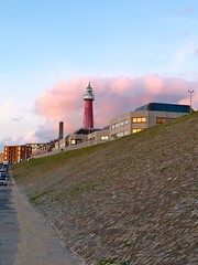 Lighthouse on a Dyke (grevillea.) Tags: ocean sea lighthouse coast scheveningen thenetherlands northsea dyke thehague southholland wbnawnl