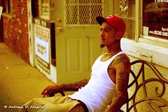 Smoke Break (Autumn D. Ahlgrén) Tags: urban male hat tattoo ink bench artist gang headshot mexican storefront wifebeater smokebreak barredwindows flintmiusa