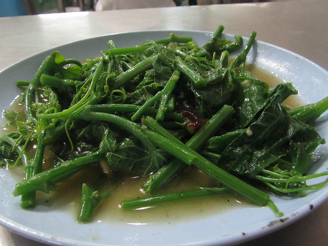 Pad yord mala (stir fried bitter melon leaves)