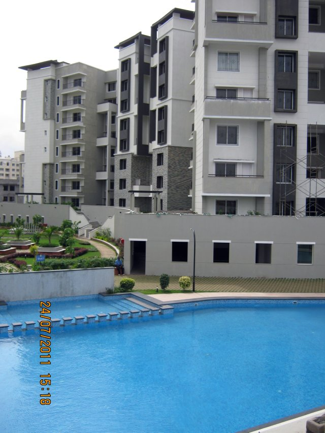 "Swimming Pool, Landscaped Garden on the Podium and Residential Tower at Sobha Carnation - on the day of launch of ""Sobha Garnet - 3 BHK & 4 BHK Flats"" - off NIBM Road -  at Kondhwa - Pune"
