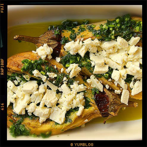 Grilled aubergines with olive oil, garlic, parsley and feta