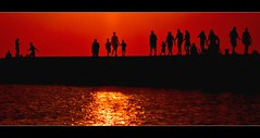 silhouettes in motion (laura's POV) Tags: sunset summer people lake water silhouette fun pier michigan lakemichigan greatlakes recreation ludington mygearandme mygearandmepremium mygearandmebronze mygearandmesilver mygearandmegold ringexcellence lauraspointofview lauraspov artistoftheyearlevel3 artistoftheyearlevel4 artistoftheyearlevel5 artistoftheyearlevel6
